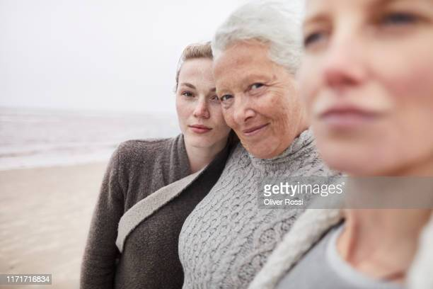 portrait of grandmother, mother and daughter on the beach - schleswig holstein stock pictures, royalty-free photos & images