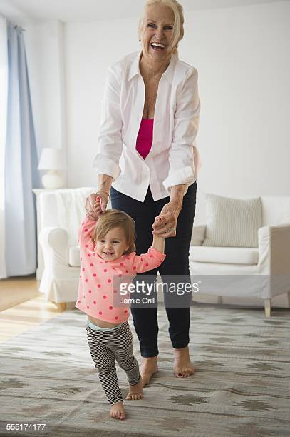 Portrait of grandmother playing with granddaughter (2-3)