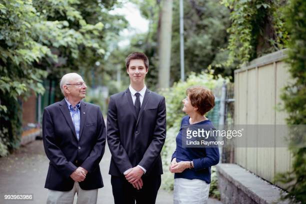 Portrait of grandparents with teenage boy