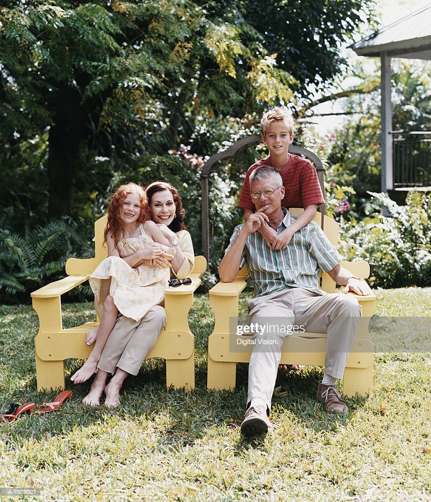Portrait of Grandparents With Their Grandchildren in a Garden : Stock Photo