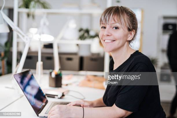 portrait of graphic designer in scandinavia, working on laptop. - smiling stock pictures, royalty-free photos & images