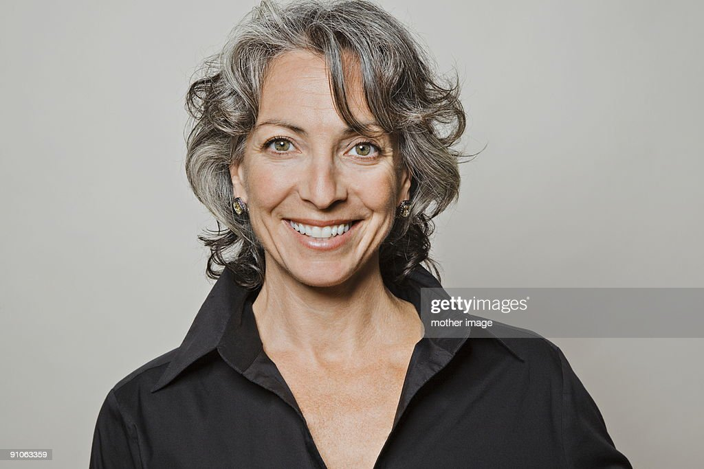 Portrait of Gray haired woman smiling : Stock Photo