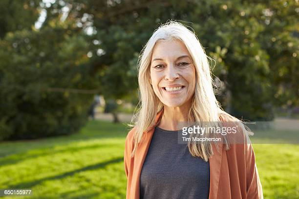 Portrait of grey haired senior woman looking at camera smiling