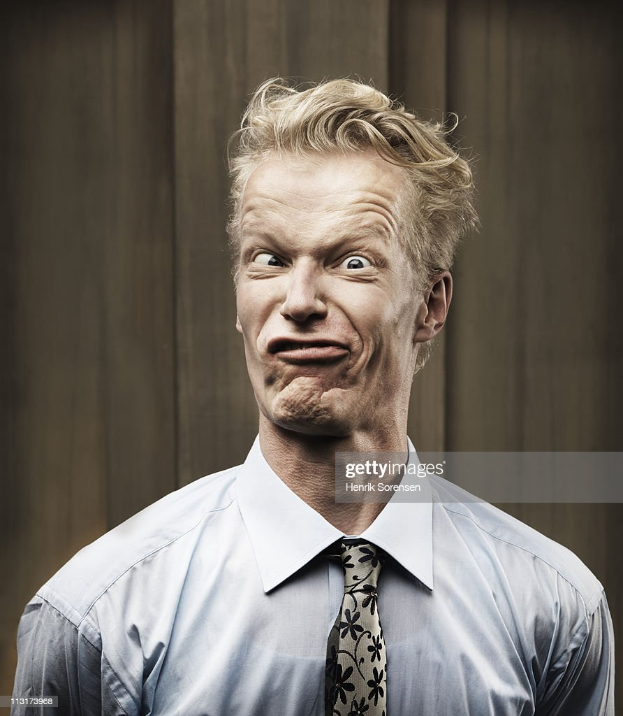 Portrait of grimacing businessman : Stock Photo