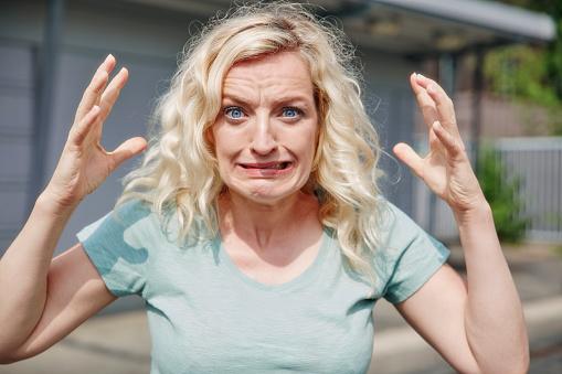 Portrait of grimacing woman outdoors - gettyimageskorea