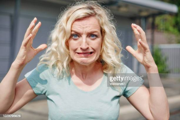 portrait of grimacing woman outdoors - anger stock pictures, royalty-free photos & images