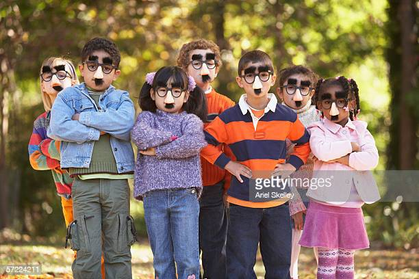 portrait of group of children wearing funny nose and glasses - nose mask stock pictures, royalty-free photos & images