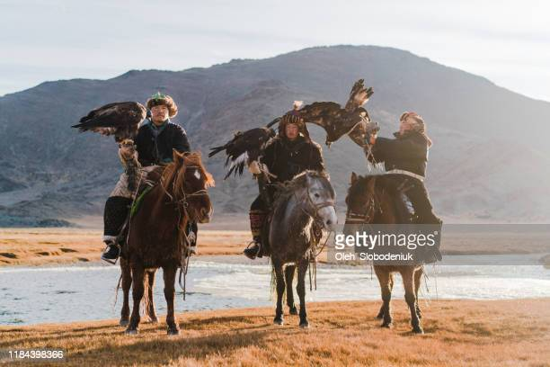 portrait of group of eagle hunters near the river in mongolia - gobi desert stock pictures, royalty-free photos & images