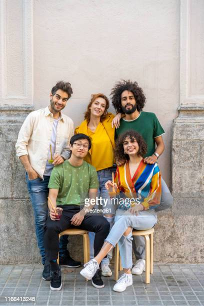 portrait of group of friends on pavement in the city - organised group photo stock pictures, royalty-free photos & images