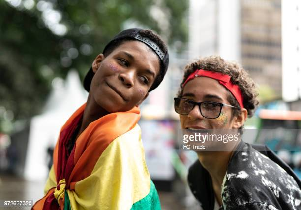 portrait of group of gay friends dancing at gay parade - bisexuality stock pictures, royalty-free photos & images