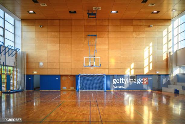 portrait of gym and parquet basketball court - sports court stock pictures, royalty-free photos & images