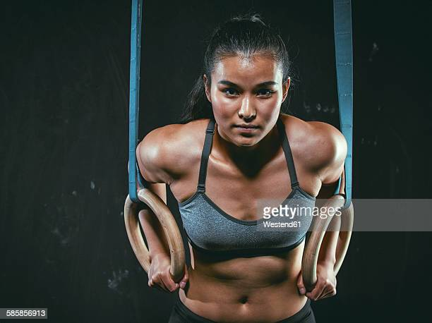 Portrait of gym athlete with gymnastic rings