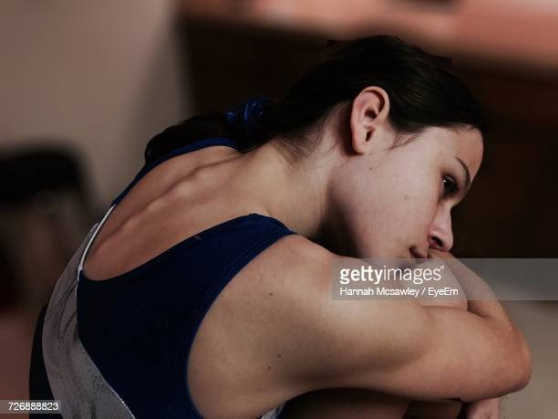 portrait of gymnast hugging knees - leotard stock pictures, royalty-free photos & images