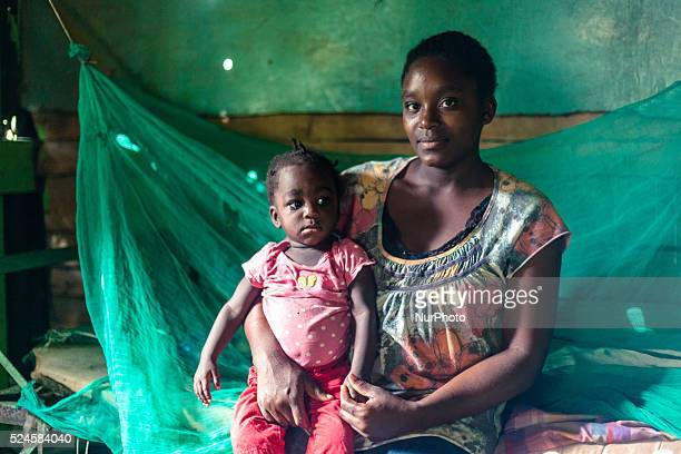 Portrait of haitian migrants woman with her son in the Dominican Republic Thousands of descendants of haitian migrants in the Dominican Republic are...