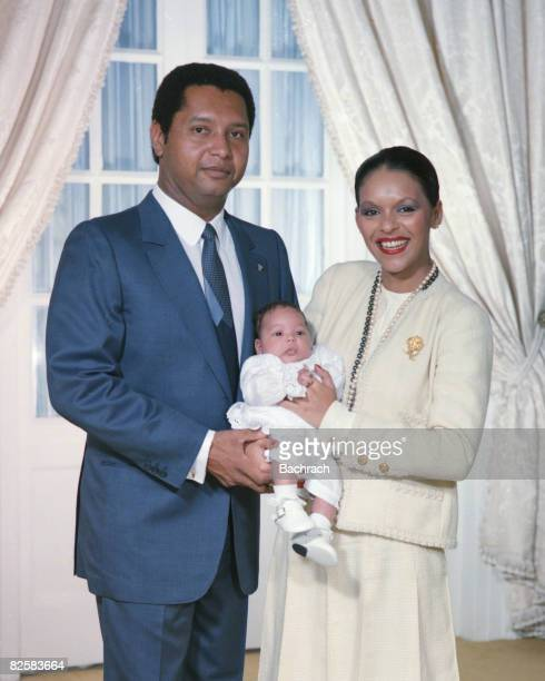 Portrait of Haitian President Jean-Claude Duvalier and his wife, Michele Bennett Pasquet, as they pose with their first-born child Francois Nicolas...