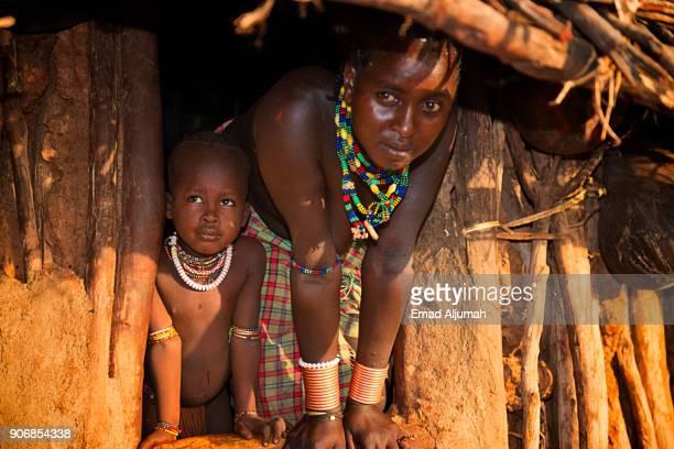 Portrait of Hamar tribe woman and her child, Turmi, Ethiopia - December 12, 2017