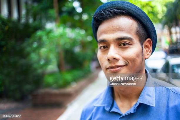 Portrait of handsome Asian man outdoor in fedora