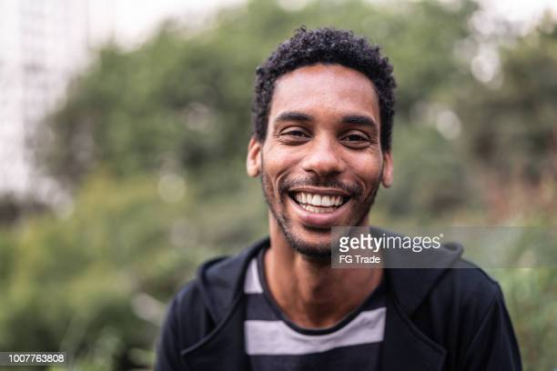 portrait of handsome latino african man - brazilian men stock photos and pictures