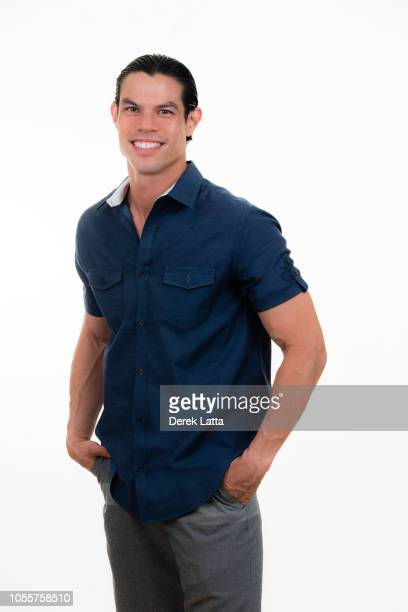Portrait of handsome male in his 30s smiling with hands in pockets'n