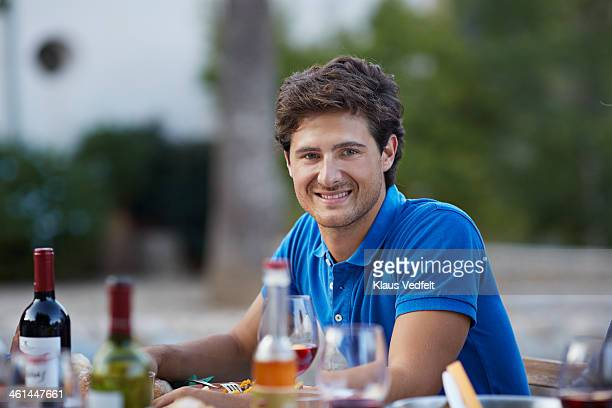 Portrait of handsome man at dinner party
