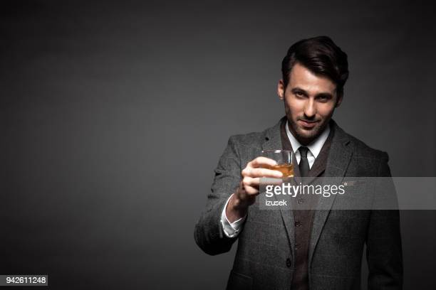 Portrait of handsome man drinking whiskey
