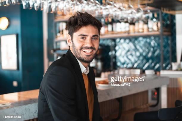 portrait of handsome man in bar establishment - bar drink establishment stock pictures, royalty-free photos & images