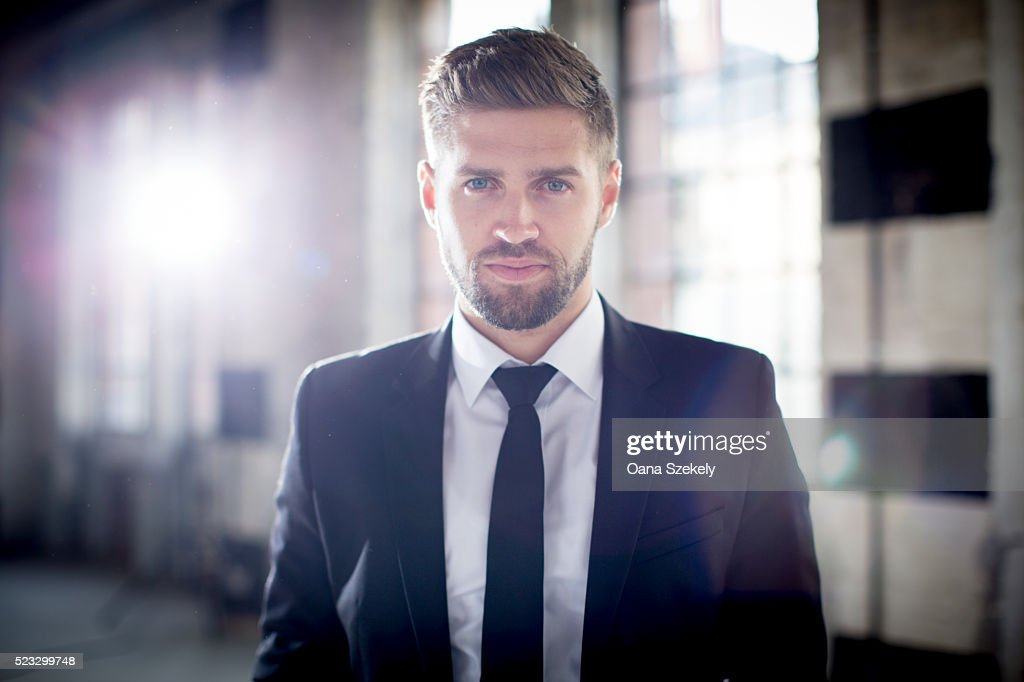 Portrait of handsome man in suit : Stock Photo