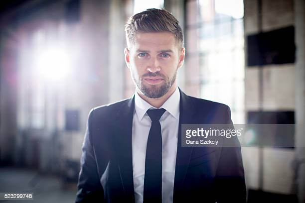 portrait of handsome man in suit - handsome pakistani men stock photos and pictures