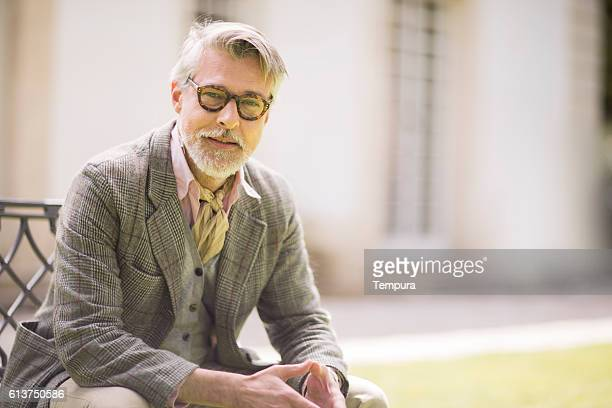 portrait of handsome man looking at camera. - handsome 50 year old men stock photos and pictures