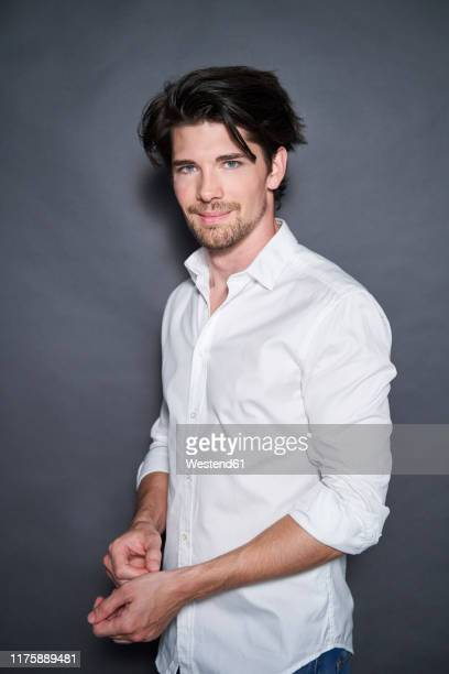 portrait of handsome man wearing white shirt - 白いシャツ ストックフォトと画像