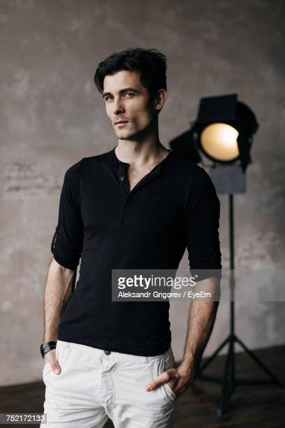 Portrait Of Handsome Man With Hands In Pockets Standing At Film Studio