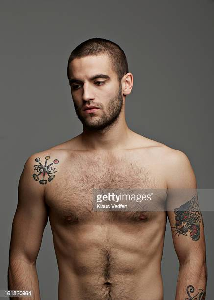 portrait of handsome man with tatoo's - male torso stock photos and pictures