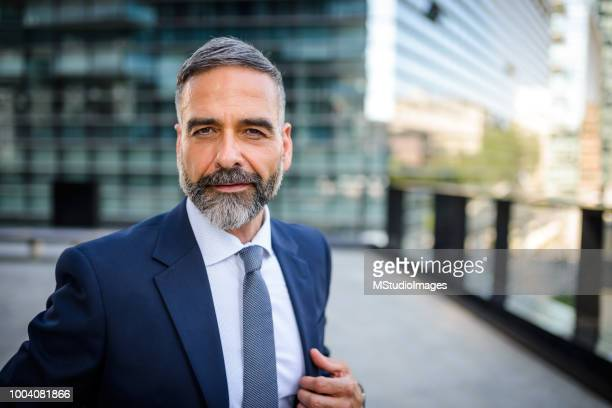 portrait of handsome mature businessman - handsome 50 year old men stock pictures, royalty-free photos & images