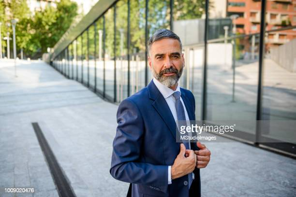 portrait of handsome mature businessman - 50 59 years stock pictures, royalty-free photos & images
