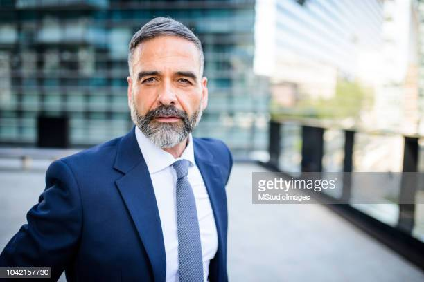 portrait of handsome mature businessman - giacca foto e immagini stock