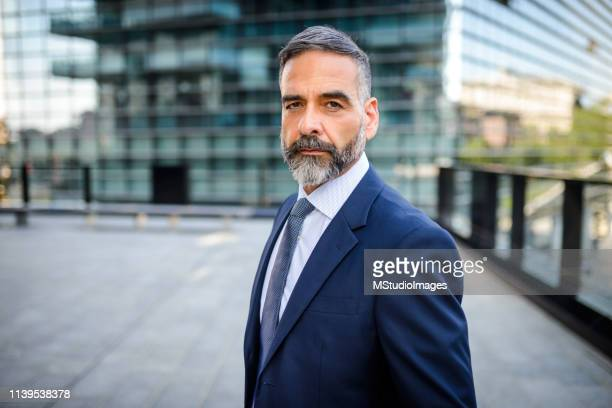 portrait of handsome mature businessman - white blazer stock pictures, royalty-free photos & images