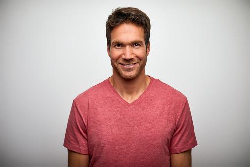Portrait of handsome mid adult man smiling - gettyimageskorea