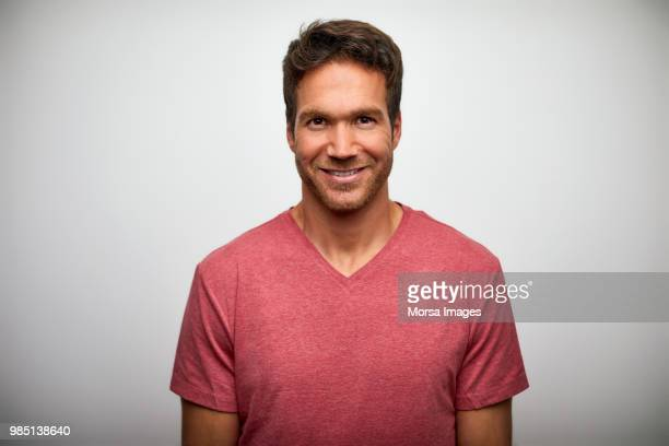 portrait of handsome mid adult man smiling - 30 39 years stock pictures, royalty-free photos & images