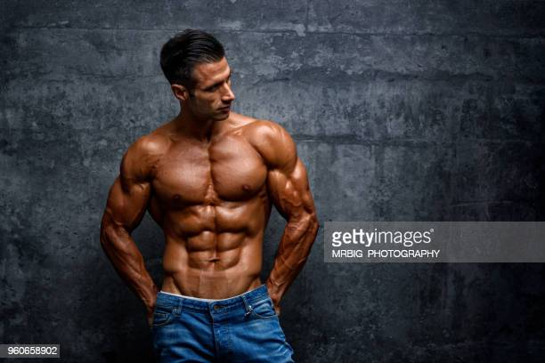 portrait of handsome muscular men outside - male torso stock photos and pictures