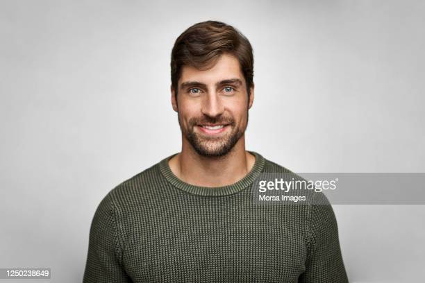 portrait of handsome smiling man in casuals - one mid adult man only stock pictures, royalty-free photos & images
