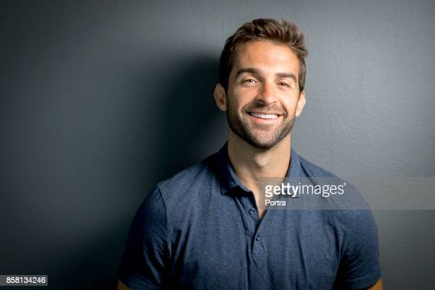 portrait of handsome smiling mid adult man - mid adult men stock pictures, royalty-free photos & images