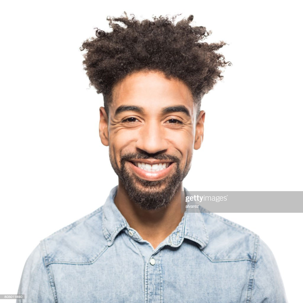 Portrait of handsome young african man smiling : Stock Photo