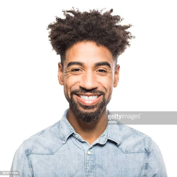 portrait of handsome young african man smiling - front view photos stock photos and pictures