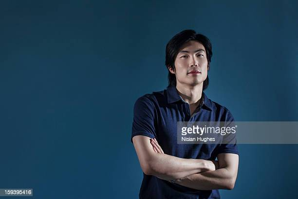 Portrait of handsome young Asian man