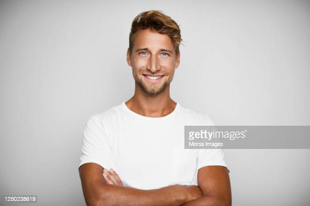 portrait of handsome young man on white background - mid volwassen mannen stockfoto's en -beelden
