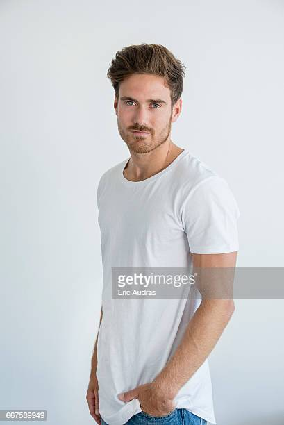 portrait of handsome young man posing - dreiviertelansicht stock-fotos und bilder