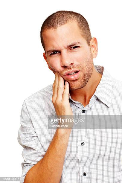 Portrait of handsome young man with a toothache