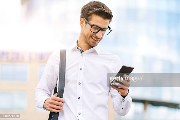Portrait of handsome young man with mobile phone