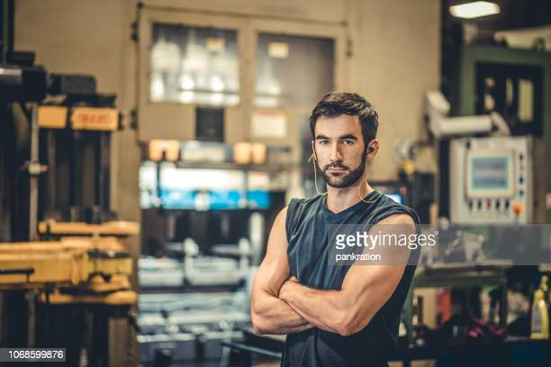 portrait of handsome young worker in metal industry - ear protection stock pictures, royalty-free photos & images