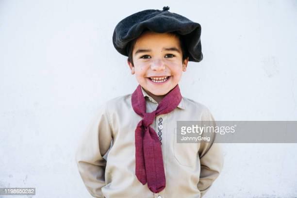 portrait of happy 5 year old gaucho in traditional clothing - argentina stock pictures, royalty-free photos & images